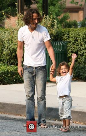 Chris Cornell and his daughter Toni smile for the photographers as the musician spent some quality time with his two...