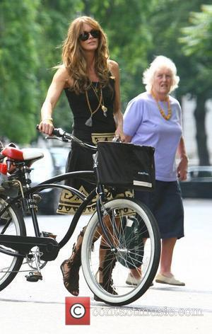 Elle Macpherson arrives on her bicycle to pick up her daughter from school London, England - 09.06.08