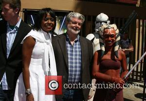 George Lucas and his girlfriend Melody Hobson 'Star Wars: The Clone Years' premiere at the Egyptian Theater - arrivals Los...
