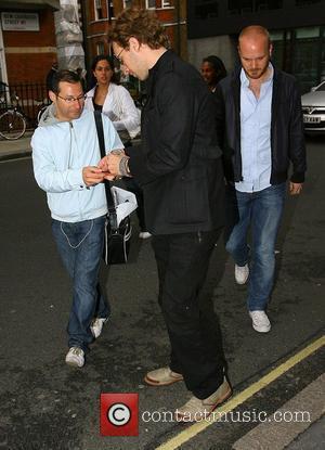 Chris Martin of Coldplay Leaving the BBC Radio One studios London, England - 12.06.08