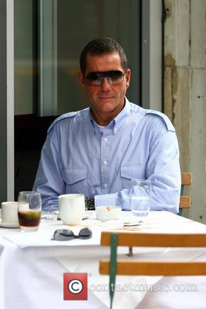 Dale Winton leaves a small tip and large mess on his table after enjoying a coffee with a friend, outside...