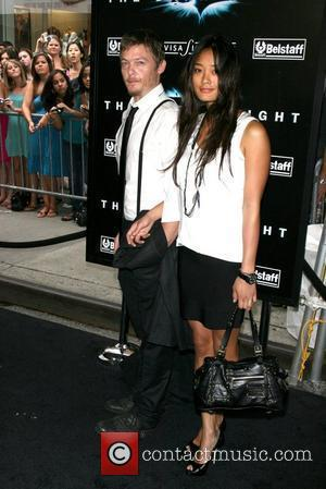 Norman Reedus and guest New York Premiere of 'The Dark Knight' held at AMC Loews Lincoln Square - Arrivals New...
