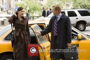 Maggie Gyllenhaal and Aaron Eckhart