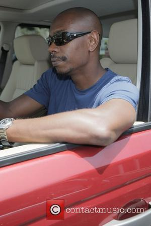 Comedian Dave Chappelle drives his red Range Rover out of Fred Segal in West Hollywood Los Angeles, California - 27.06.08