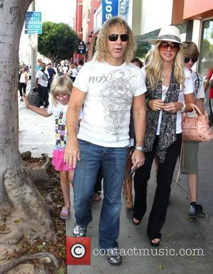 Bon Jovi keyboard player David Bryan shops on Robertson Blvd with his family Los Angeles, California - 12.08.08