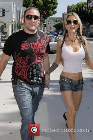 'Sons of Hollywood' reality TV star David Weintraub and her new girlfriend walk down Robertson Boulevard after picking up coffee...