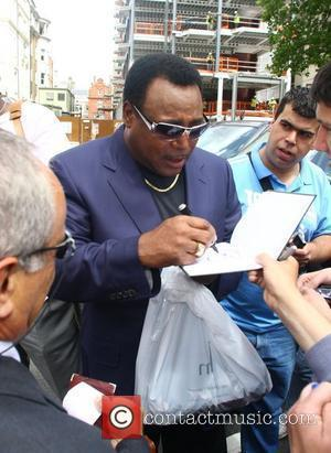 George Benson signs autographs for fans outside the Dorchester hotel London, England - 26.06.08