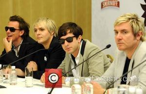 John Taylor, Nick Rhodes, Simon Le Bon of Duran Duran with Mark Ronson (c) at a press conference before the...
