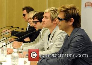 John Taylor, Nick Rhodes, Simon Le Bon and Andy Taylor of Duran Duran with Mark Ronson (c) at a press...