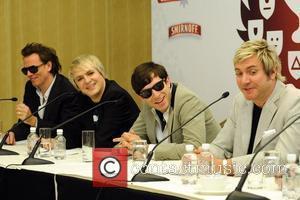 John Taylor, Nick Rhodes, Simon Le Bon of Duran Duran with Mark Ronson (c) at a press conference before the...
