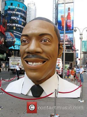 A 15 foot tall replica of Eddie Murphy's head is placed in Times Square to promote the release of his...