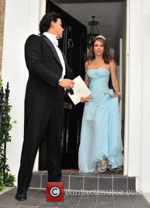 Arun Nayar and Elizabeth Hurley  leaving home to attend Elton John's party London, England - 26.06.08