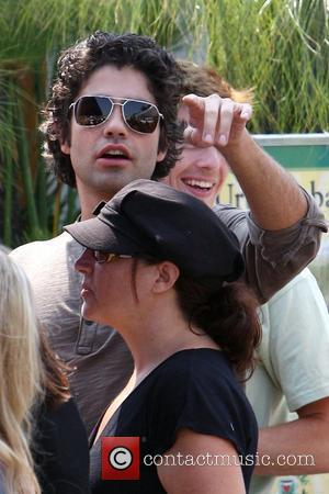 Adrian Grenier The cast of HBO's 'Entourage' filming a scene at the Urth Cafe on Melrose Avenue in West Hollywood...