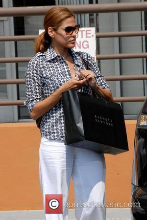 'Ghost Rider' star Eva Mendes leaving a liquor store in West Hollywood carrying a large Barneys New York shopping bag...
