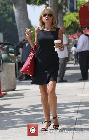 'Hope and Faith' star Faith Ford carrying a large hot coffee on a hot summer day Los Angeles, California -...