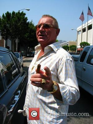 Frederic Prince von Anhalt smokes a cigar as he leaves the Ivy restaurant Los Angeles, California - 24.06.08