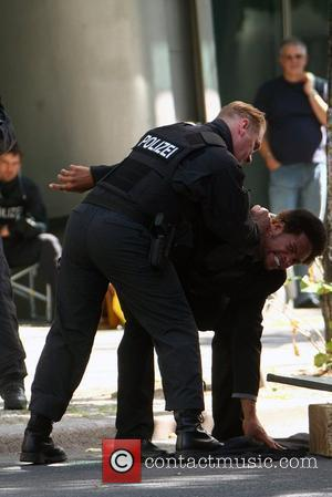 C.S.I. star Gary Dourdan and an actor in a police uniform at the set of the movie Fire in Charlottenburg...