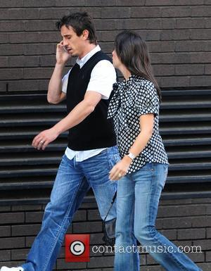 Gary Neville and his  wife Emma, who is said to be expecting the couple's first child, walking down Deansgate Manchester,...