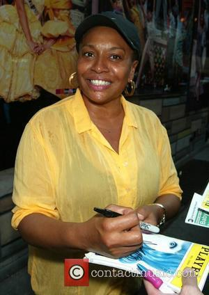Jenifer Lewis signs autographs for fans after appearing in the Broadway musical 'Hairspray' at the Neil Simon Theatre. New York...