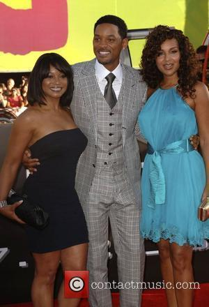 Will Smith, Lisa Raye(r) and guest 'Hancock' Los Angeles Premiere - Arrivals held at the Grauman's Chinese Theatre Hollywood, California...