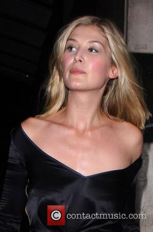 Rosamund Pike leaving the press night for the stage production of 'The Harder They Come' at the Playhouse Theatre London,...