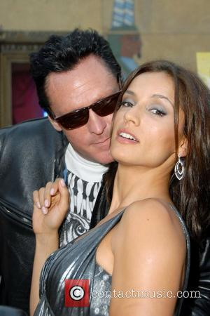 Michael Madsen (L) and actress Leonor Varela Premiere of 'Hell Ride' at the Egyptian theater in Hollywood Los Angeles, California...