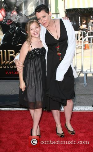 Lori Petty and guest The 'Hellboy 2: The Golden Army' premiere at the Mann Village Theater Los Angeles, California -...