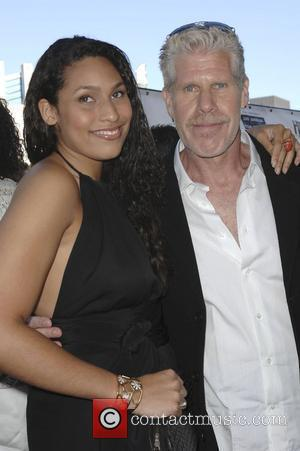 Ron Perlman with his daughter The 'Hellboy 2: The Golden Army' premiere at the Mann Village Theater Los Angeles, California...