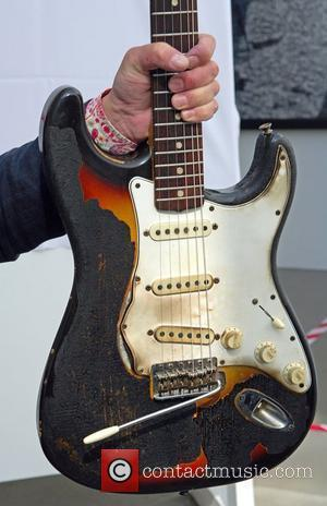 Jimi Hendrix's1965 Fender Stratocaster, Photocall at the Idea Generation Gallery ahead of an auction for famous music memorabilia London, England...
