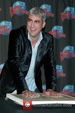 Taylor Hicks  from American Idol celebrates his Broadway debut in Grease with a handprint ceremony at Planet Hollywood in...
