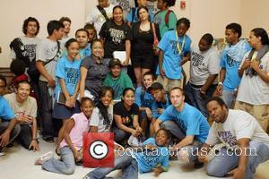 Dawn Richards of Danity Kane poses with Claw Money and teen members of Words Beats & Life Metro TeenAIDS event...