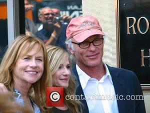 Holly Hunter and Ed Harris Holly Hunter is honored with a star on the Hollywood Walk of Fame Los Angeles,...