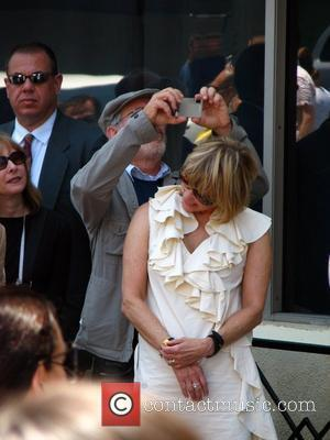 Kate Capshaw and Steven Spielberg Holly Hunter is honored with a star on the Hollywood Walk of Fame Los Angeles,...