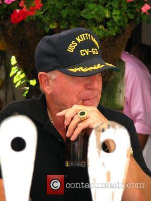 Frederic Prinz von Anhalt hiding behind a 'USS Kitty Hawk' hat while eating lunch at Ivy restaurant Los Angeles, California...