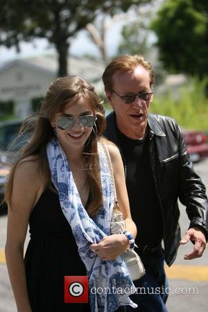 James Woods and a lady friend attempt to escape photographers after having lunch at Cafe Med in the Sunset Plaza...