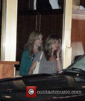 Jennifer Aniston and a friend leaving Sunset Towers in West Hollywood
