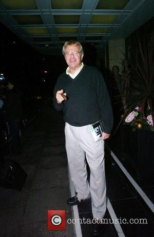 Jerry Springer  smokes a cigar outside the Dorchester Hotel London, England - 24.06.08