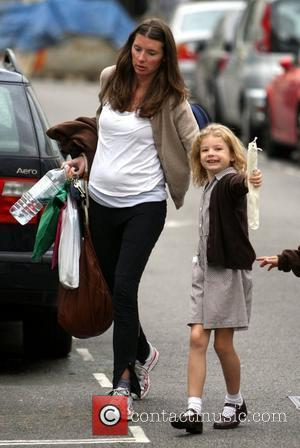 Jools Oliver shows off her new baby bump after she and husband Jamie Oliver announced that they are expecting their...