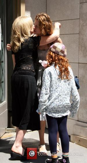 Sandra Bernhard and Her Daughter Cicely Yasin Bernhard Leaving The Kabbalah Centre