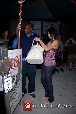 Reggie Bush and Kim Kardashian leaving Koi restaurant Los Angeles, California - 01.07.08