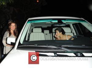 Kim Kardashian and Khloe Kardashian At El Sole