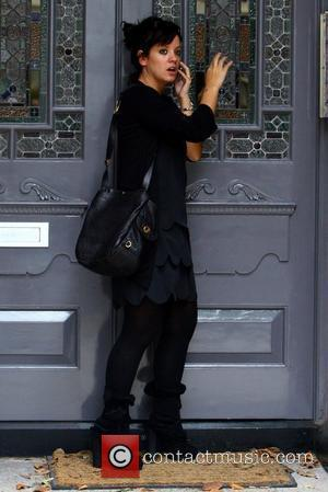 Lily Allen arriving home in a pair of very high-heeled shoes London, England - 08.09.09