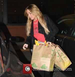 Lohan: 'Paparazzi Make Me Look Drunk'