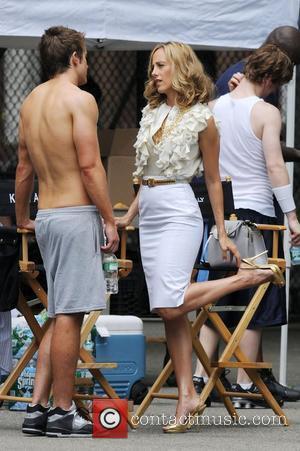Kim Raver, Robert Buckley on the film set for 'Lipstick Jungle' at the East Village New York City, USA -...