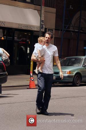 Guy Oseary and his child depart a Kabullah service New York City, USA - 28.06.08