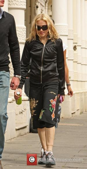 Madonna Upset Over Family Snapshots
