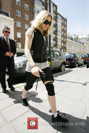 Madonna Tot Arrives In Britain