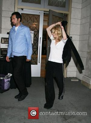 Guy Oseary and Madonna outside the Kabbalah centre at a special late night service to mark the full moon. The...