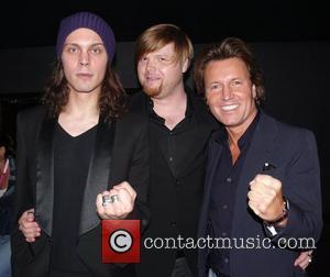 Ville Valo (HIM), Franz Waldkarper (Warner Music Germany), Bernd Dopp (CEO Warner Music Germany) Reception before the Madonna concert (Sticky...