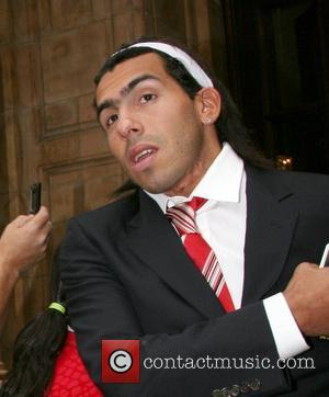 Carlos Tevez Manchester United football team leaving The Landmark Hotel for their match against Portsmouth at Wembley London, England -...